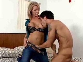 Busty milf gives her stud a handjob