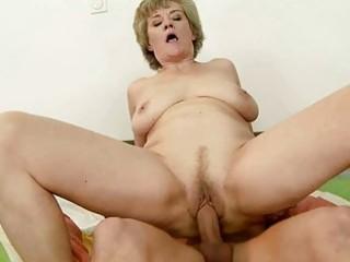 busty grandma enjoys sex with youthful chap