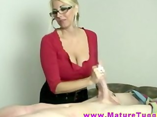 Blonde MILF massages cock with her hands