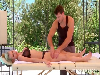 Busty blonde gets her sexy body massaged sensually
