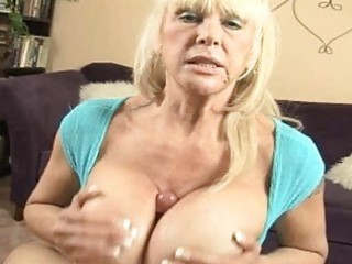 Tanned blonde momma with massive hooters doing