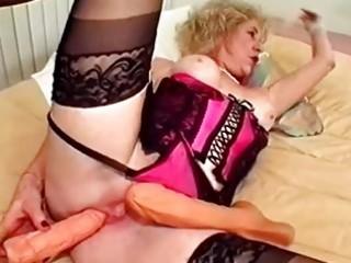 granny vibrator bonks her pussy