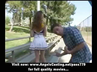 breathtaking redhead cheerleader teen doing