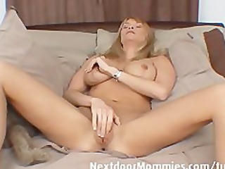 aged woman with massive milk cans masturbates