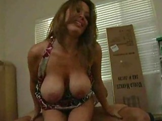 brunette mother i with large scoops bounces up