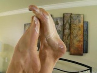super titted wife gives a fantastic footjob