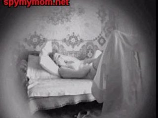 mommy fingering in bed and watching her fur pie