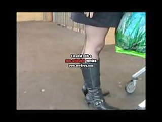 Black seamed stockings boots and a mini skirt